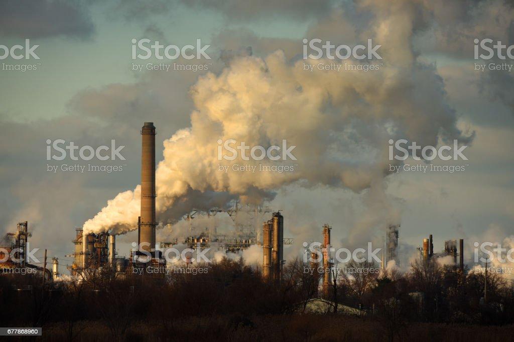 Heavy Smoke at Oil Refinery stock photo