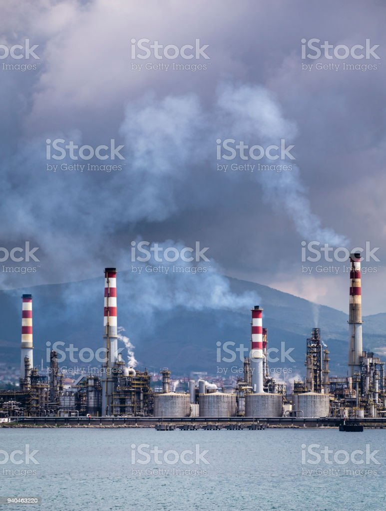 Heavy smoke over an oil refinery stock photo