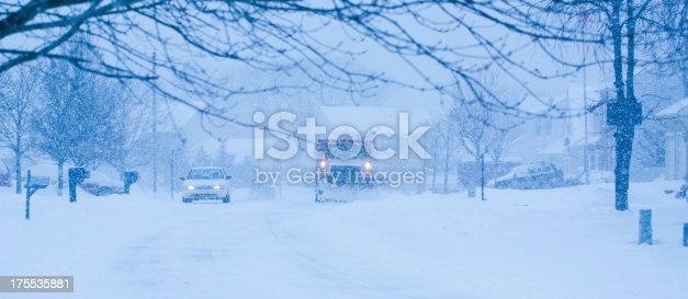 536171925 istock photo Heavy snowfall and a car behind  snowplow 175535881
