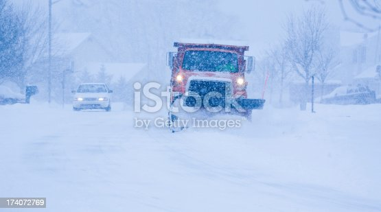536171925 istock photo Heavy snowfall and a car behind the snowplow 174072769