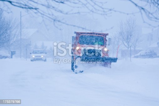 536171925 istock photo Heavy snowfall and a car behind the snowplow 175379766