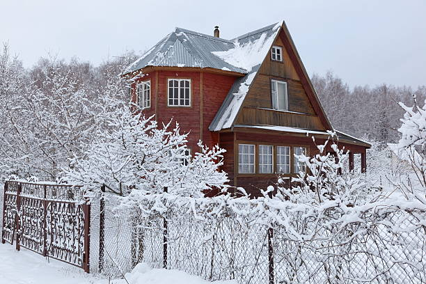 Heavy snowfall at countryside house in Moscow region, Russia House in countryside after heavy snowfall. Moscow region. Russia. russian dacha stock pictures, royalty-free photos & images