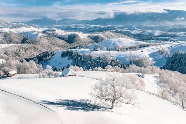 Heavy snowfall in Romania in the Rucar Bran Pass in Transylvania near Brasov and Sinaia stock photo