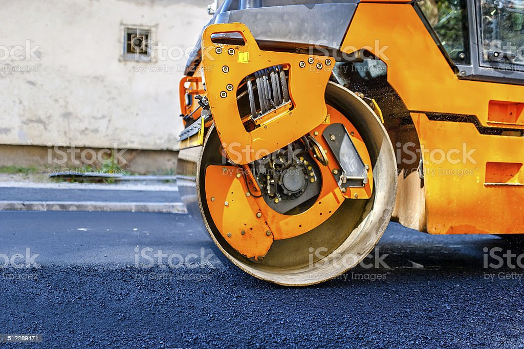 Heavy Tandem Vibration roller compactor at asphalt pavement work stock photo