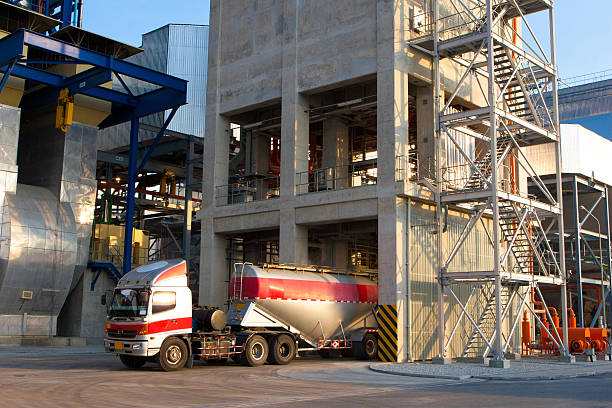 Heavy truck loading the cement powder from silos stock photo