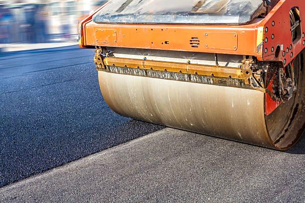 Heavy Vibration roller at asphalt pavement works stock photo