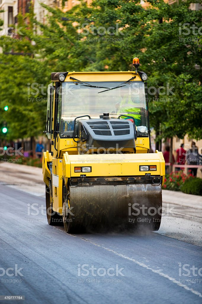 Heavy Vibration roller compactor at asphalt pavement works stock photo
