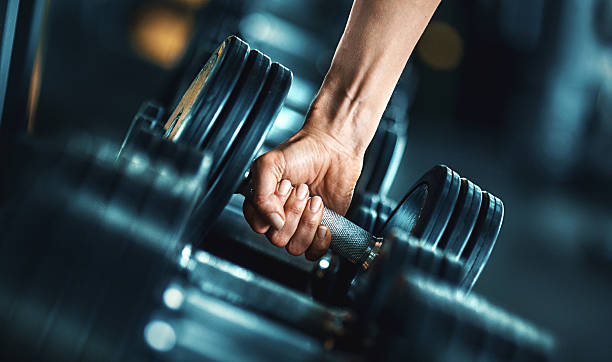 heavy weight exercise. - health club stock photos and pictures