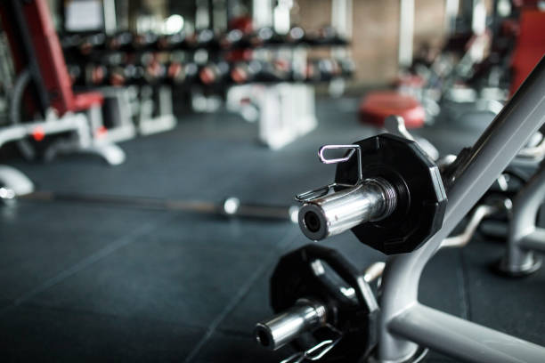 heavy weights barbell in the fitness gym - health club stock photos and pictures