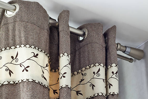 heavy woolen curtains  with ring-top rail stock photo