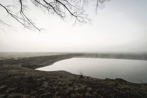 Heavy_fog_blanket_obscuring_horizon stock photo