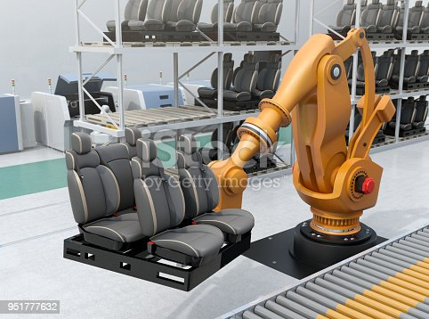 istock Heavyweight robotic arm carrying car seats in car assembly production line 951777632