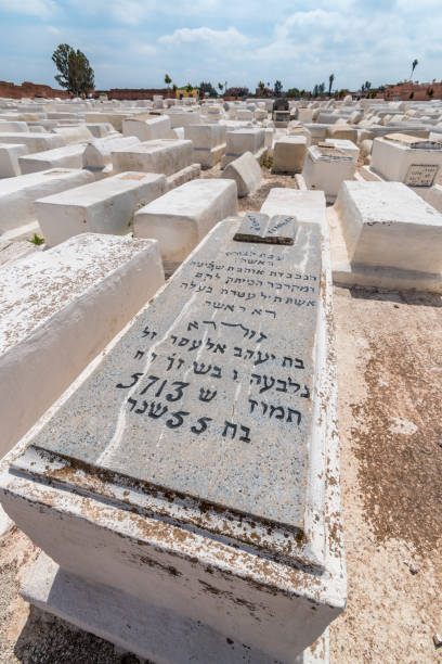 Hebrew script on an old grave in Jewish cemetery in Marrakesh stock photo
