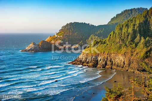 Stock photograph of  the Heceta Head Lighthouse on the Oregon coastline, USA on a sunny evening.