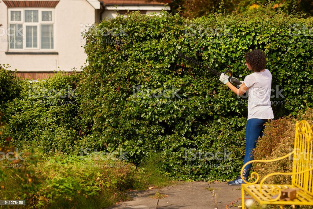 a young woman trims her bush