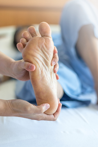 istock Heel Pain or plantar fasciitis concept. Hand on foot as suffer from inflammation feet problem of Sever's Disease or calcaneal apophysitis. 1175813620