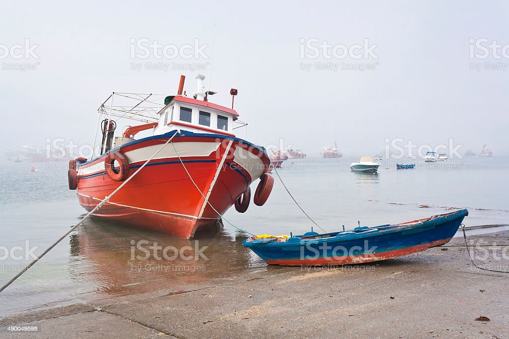 Heeled boat stock photo