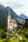 Heiligenblut - beautiful village in the Austrian Alps. Gothic church of St. Vincenzo. The beginning of the road Grossglocknerstrasse. The concept of ecological, historical and phototourism