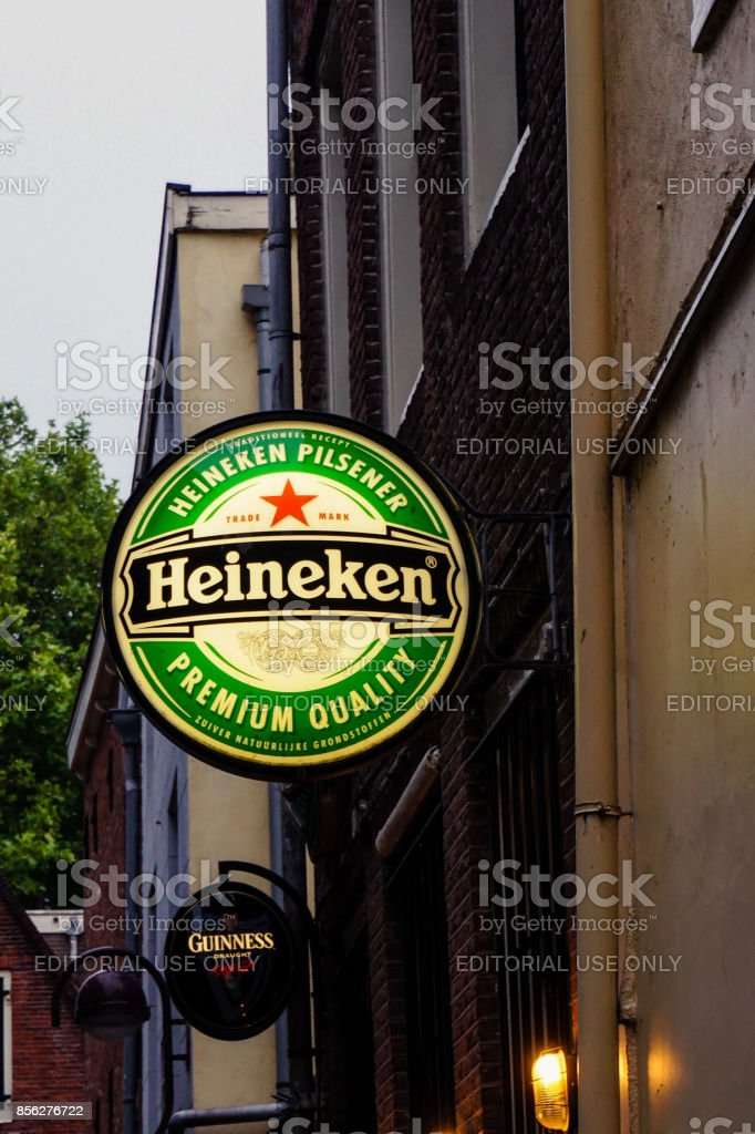 Heineken logo hang on the wall building in Amsterdam. July 2017 Amsterdam NL stock photo
