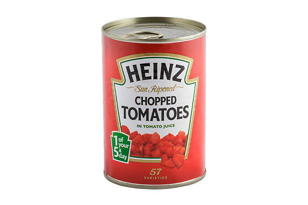 heinz chopped tomatoes - tomato can stock photos and pictures