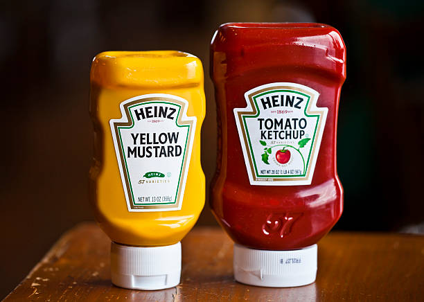 heinz ketchup and mustard - heinz stock photos and pictures