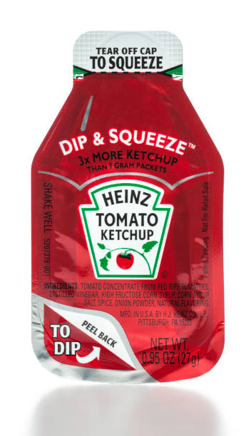 heinz tomato ketchup dip & squeeze package - heinz stock photos and pictures