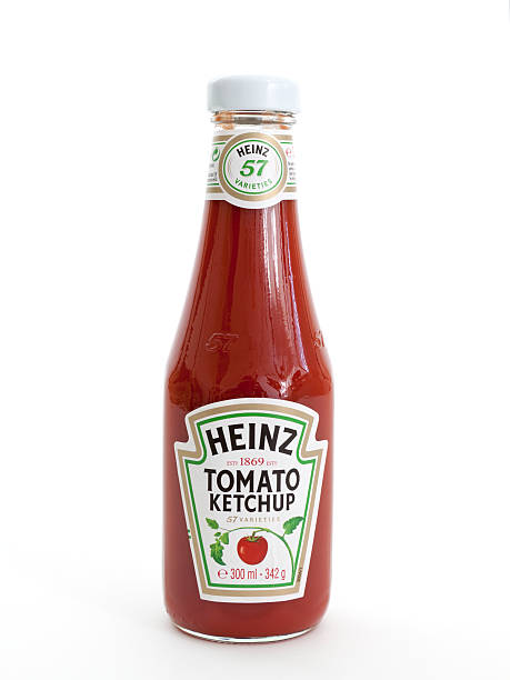 Heinz Tomato Ketchup Maarssen, The Netherlands - November 24, 2011: Studio shot of a bottle of Heinz Tomato Ketchup, manufactured by H.J. Heinz Company ketchup stock pictures, royalty-free photos & images