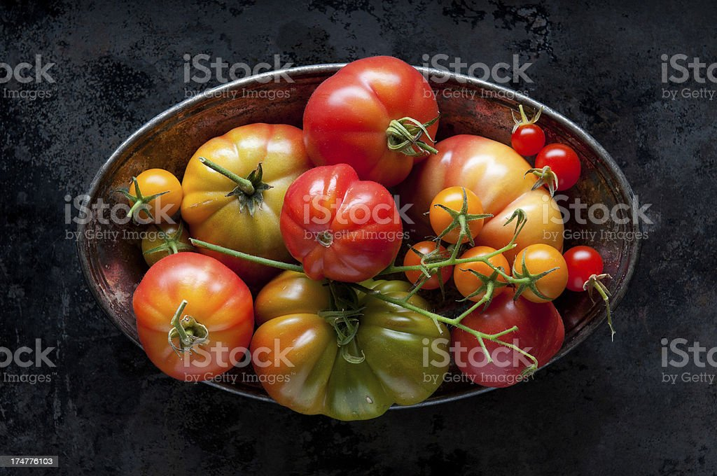 Heirloom Tomatoes in a Tarnished Bowl stock photo