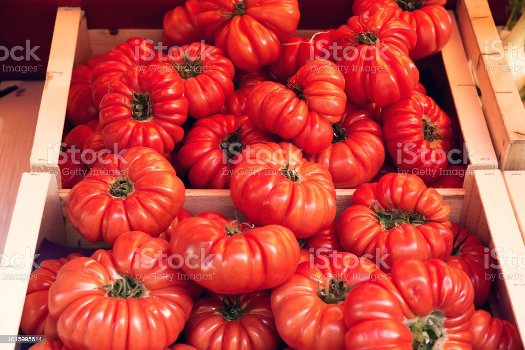 Heirloom tomatoes in French open air market stand