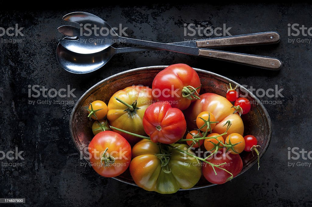 Heirloom Tomatoes with Serving Spoon and Fork royalty-free stock photo