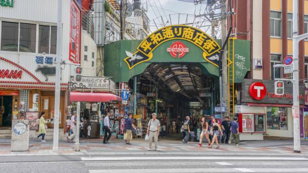 Heiwadori street at Kokusai street in Naha, Okinawa, Japan. There are many food and souvenir shops. OKINAWA, JAPAN - April 19 , 2017: Heiwadori street at Kokusai street in Naha, Okinawa, Japan. There are many food and souvenir shops. kokusai dori okinawa stock pictures, royalty-free photos & images