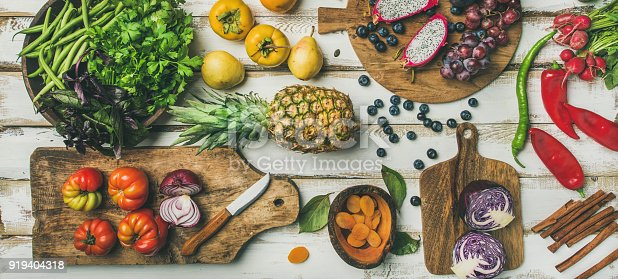 istock Helathy vegan food cooking background with fruites and vegetables 919404318