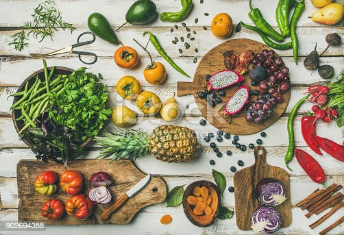 istock Helathy vegan food cooking background with fruits and vegetables 902694388