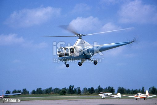 Sikorsky H-5 helicopter built about 1950 and photographed in USA in 1964. Kodachrome scanned film with grain.