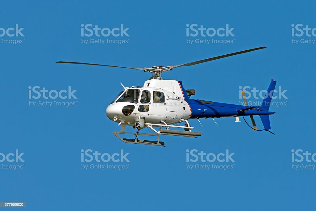 Helicopter Against Blue Sky stock photo
