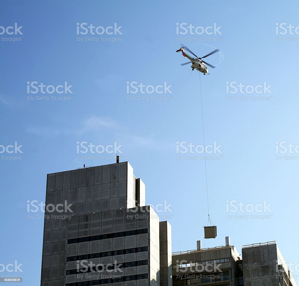 Helicopter and building material stock photo