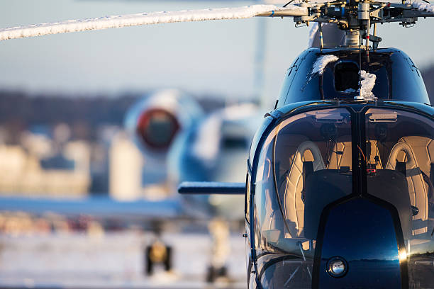 Helicopter and Business Jet stock photo