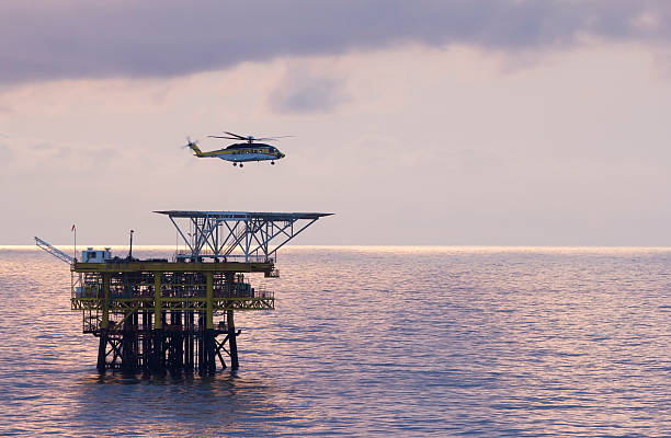 Helicopter and oil-rig stock photo