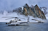 istock Helicopter and Propeller Airplane on Parking Apron at Snow-capped Mountains Backgrounds 1282533487