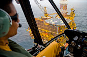 Mossel Bay, Southern Cape, South Africa, December 13,  2007.  A helicopter pilot approached drilling rig, FA Platform, which is off the coast of Mossel Bay in the Southern Cape to exchange Roughneck workers.