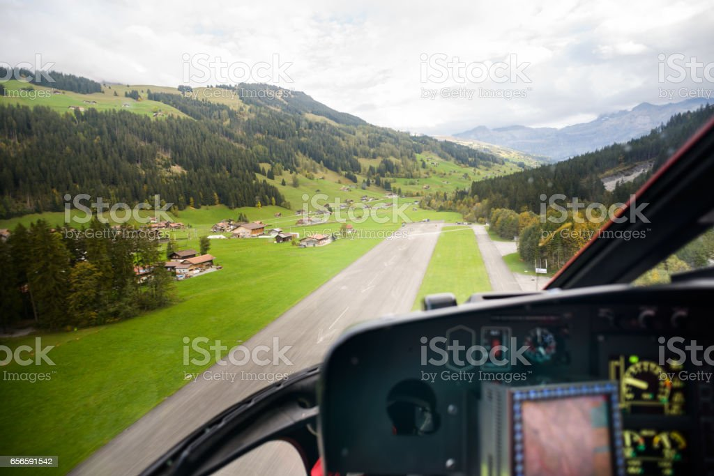 Helicopter Arriving at Mountain Air Strip POV stock photo