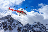 istock Helicopter at Assiniboine Lodge and Magog Lake 493833570