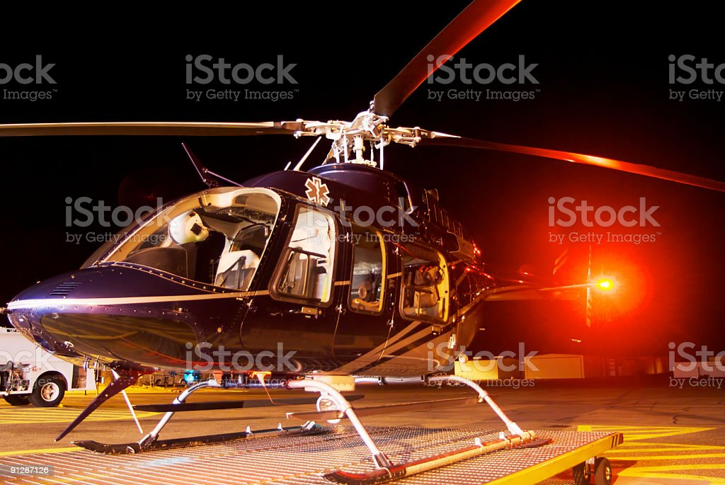 helicopter at night on tarmac stock photo