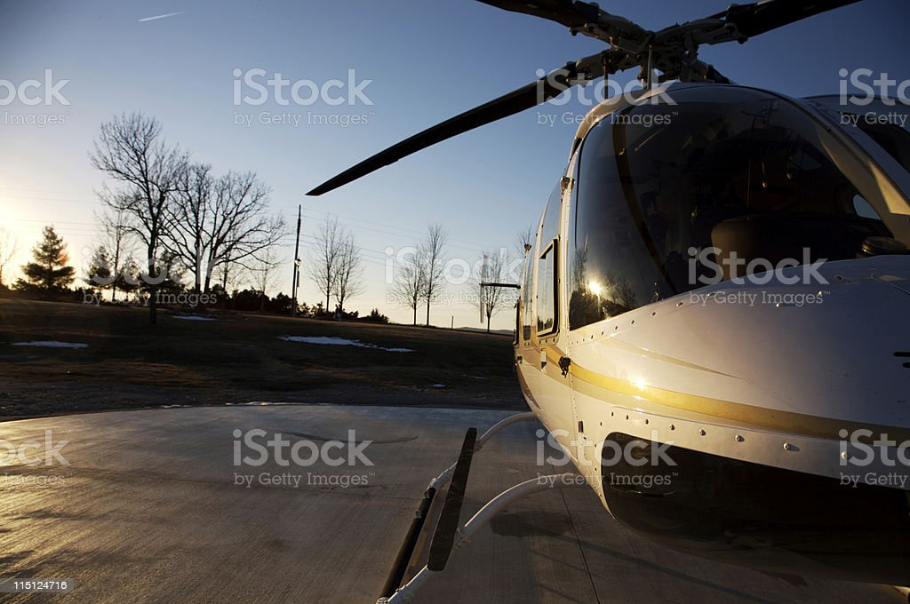 helicopter at sunset royalty-free stock photo