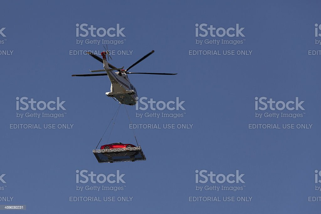 Helicopter carying sportscar. stock photo