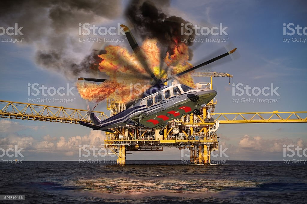 Helicopter crashes into the sea in offshore oil and rig stock photo