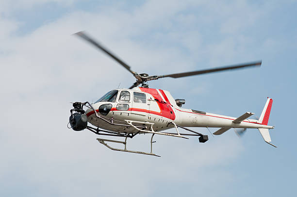 Helicopter equipped with camera stock photo