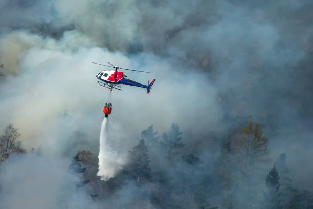 Helicopter extinguishing wildfire. Bergen, Norway. Helicopter extinguishing wildfire. Bergen, Norway. extinguishing stock pictures, royalty-free photos & images