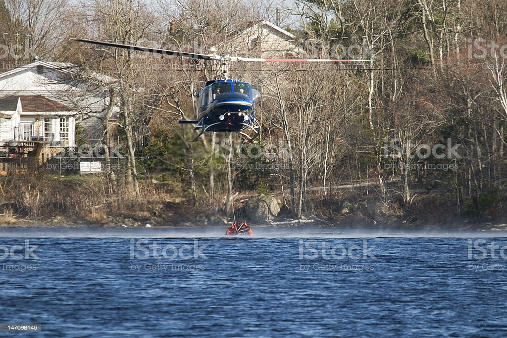 Helicopter filling its water sac near Halifax forest fire