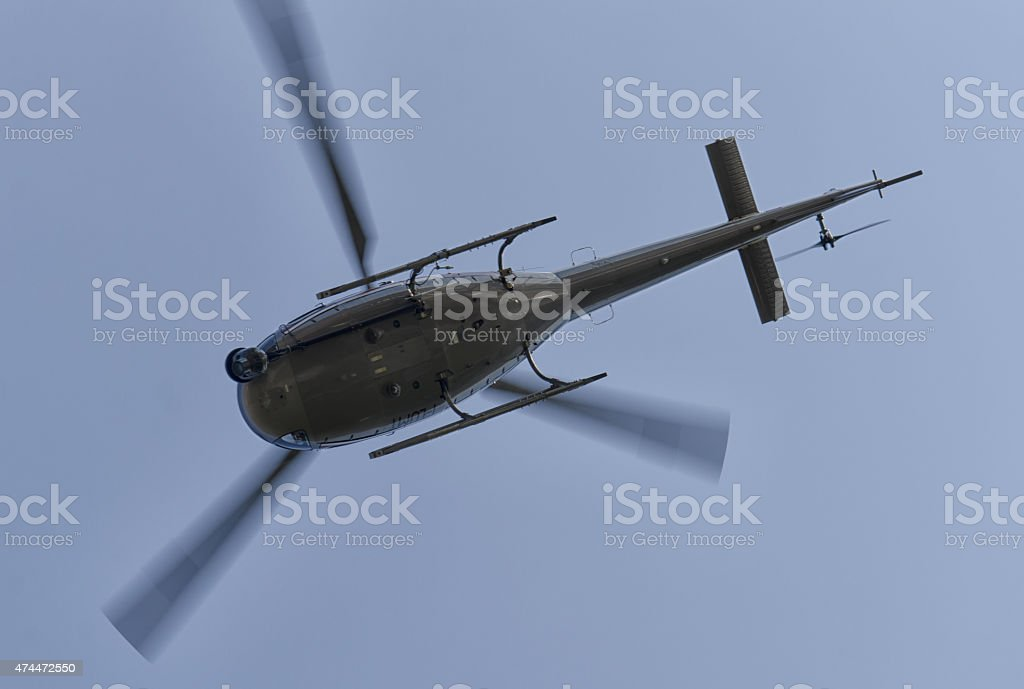 Helicopter filming a race stock photo
